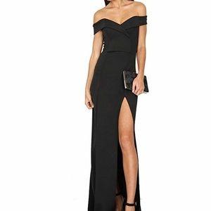 Elegant black off the shoulder dress.